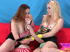 Lesbian babe getting strapon drilled