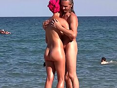 Sexy Nudist Babes Tanning Naked At The Beach
